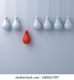Think different concept , One hanging red light bulb standing out from the dim unlit white light bulbs on white wall background , leadership and individuality creative idea concepts . 3D rendering.