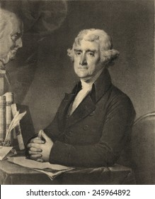 Thomas Jefferson 1743-1826 at a writing desk. At upper left is a sculpture bust of Benjamin Franklin.