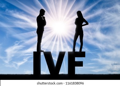 Thoughtful man and woman standing on the word IVF think of in vitro fertilization. Concept of decision-making on in vitro fertilization