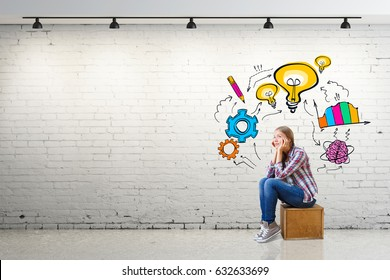 Thoughtful young european woman sitting on wooden box in white brick interior with business sketch on wall. Research concept. 3D Rendering