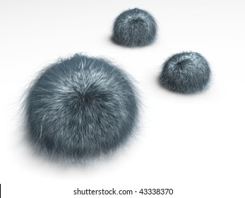 Three balls with hair lying on the ground