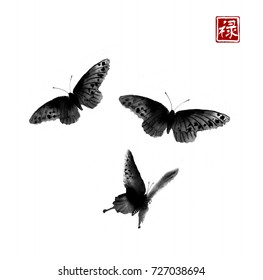 Three big butterflies on white background. Traditional oriental ink painting sumi-e, u-sin, go-hua. Hieroglyph - well-being