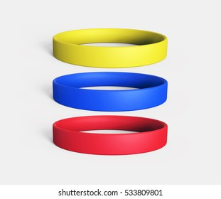 Three Blank Colorful Promo bracelets: Yellow, Blue and Red. 3D Render