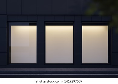 Three blank mock up posters hanging in shop window at night. Concept of advertising and marketing. 3d rendering