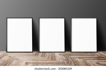three blank poster hanging on wall