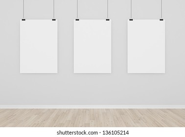 three blank posters in empty room