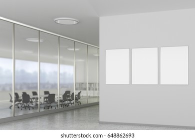 Three blank posters on the wall in bright office interior with clipping path around banner. 3d illustration