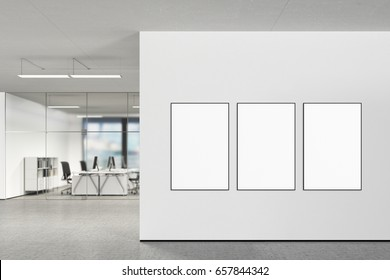 Three blank vertical posters on the wall in modern office with clipping path around poster. 3d illustration