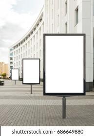 Three blank vertical street billboard poster on city background. 3d illustration.