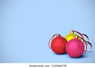 Three Christmas ball ornamnets are  on a colorful background with lots of copy space for your Christmas message title. 3D rendering.