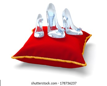 Three crystal shoes of the different size stand on a pillow. The concept for a congratulation of women on Women's Day.