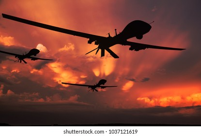 Three military drones silhouettes.  Armed with missiles. Yellow sky background. 3D illustration.