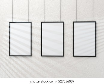 Three poster frame mockup on white wall 3d rendering