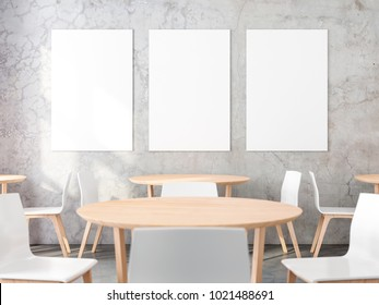 Three posters on concrete wall in cafe interior. 3d rendering