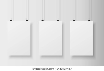 Three realistic blank white paper hanging on two office clip. Mock up template for your design. Vertical empty sheet. Show your flyers, brochures, headlines.