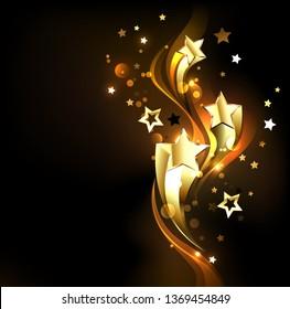 Three soaring, golden, shining stars on a dark background. Design with gold stars.