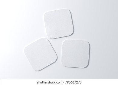Three square white coasters on white background. 3d illustration