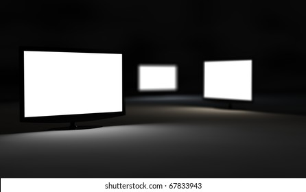 Three TV monitors illuminated isolated in the night