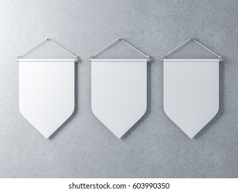 Three White pennants hanging on a concrete wall, 3d rendering