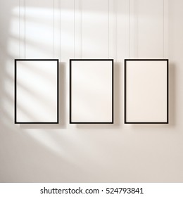 Three White posters with black frame mockup hanging on the wall with shadows, 3d rendering