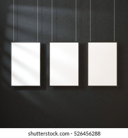 Three White posters Mockup with black frame hanging on the wall with shadows, 3d rendering