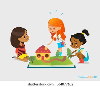 Three young smiling girls sit on floor, talk and play with pop-up book. Children s entertainment and preschool educational activity concept. Illustration for website banner, advertisement
