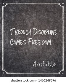 Through discipline comes freedom - ancient Greek philosopher Aristotle quote written on framed chalkboard