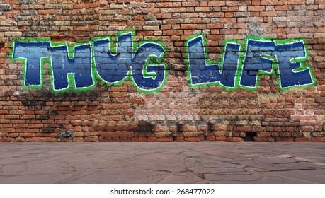 Thug life graffiti on a brick wall street scene