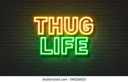 Thug life neon sign on brick wall background