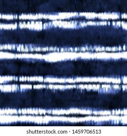 tie dyed fabric of indigo color on white cotton. Hand painted fabrics. Shibori dyeing with abstract folk striped motif  textured background. Seamless Pattern.