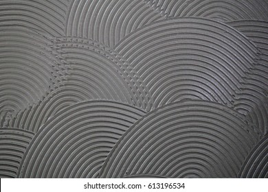 Tile adhesive notched trowel patterns. Adhesive background. Cement wall