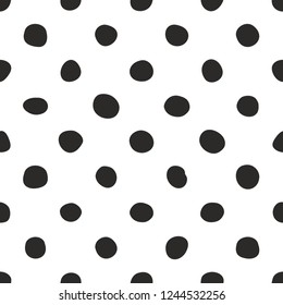 Tile pattern with black polka dots on white background for seamless decoration wallpaper