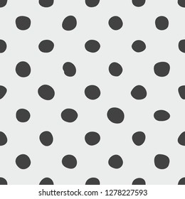 Tile pattern with black polka dots on grey background for seamless decoration wallpaper