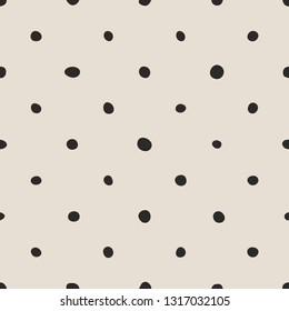Tile pattern with black polka dots on pastel pink background