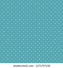 Tile pattern with small white polka dots on mint green or blue background for seamless decoration wallpaper.