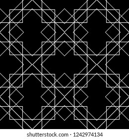 Tile pattern with white ornament on black background