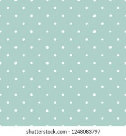 Tile pattern with white polka dots on pastel green background