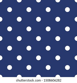 Tile pattern with white polka dots on dark blue background for decoration wallpaper