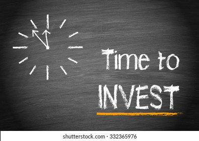 Time to invest - clock with text on blackboard background
