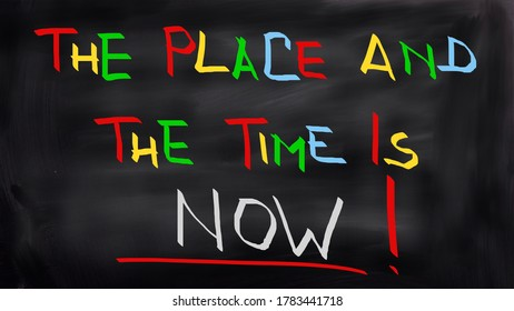 The time is now Handwritten on blackboard