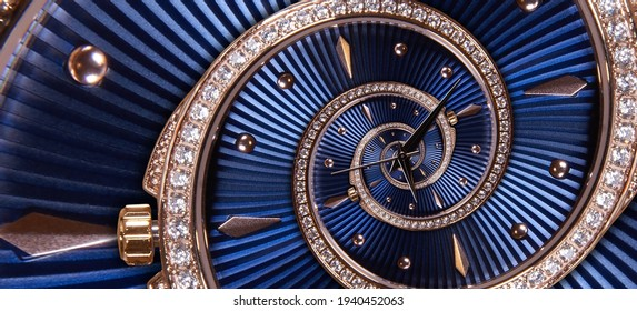Time spiral concept. Round blue diamond golden clock with hands twisted to surreal spiral. Abstract watch background with twisted ribbed dial