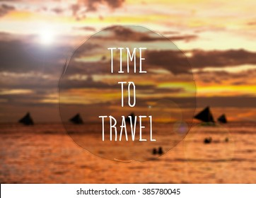 Time to travel. Motivation quote on the background of the sea/ocean with a sailing ships at the sunset.