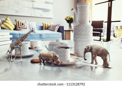 tiny african animals on the coffee table. Photo elements and 3d rendering combination. Grain and texture added