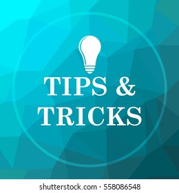 Tips and tricks icon. Tips and tricks website button on blue low poly background.