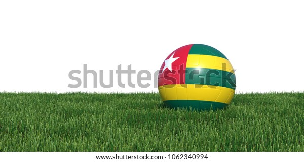 Togo Togolese flag soccer ball lying in grass, isolated on white background. 3D Rendering, Illustration.