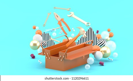 Toolbox amidst colorful balls on a blue background.-3d rendering.