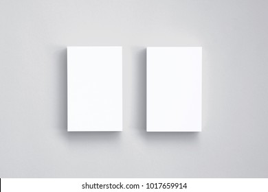 Top view of blank business cards isolated on white. 3d illustration of vertical stacks to showcase your presentation.