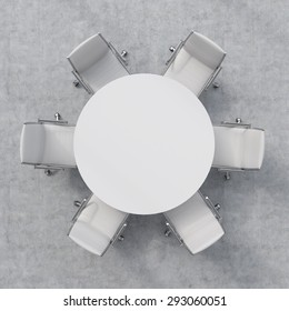 Top view of a conference room. A white round table and six chairs around. 3D rendering