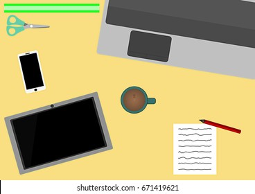Top view of a desk with laptop and tablet.
