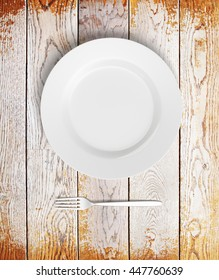 Top view of empty plate and fork on aged wooden table. Mock up, 3D Rendering
